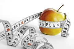 Apple and meter. Meter and apple with focus on apple. Suggesting that fruit is healthy Stock Photography