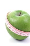 Apple and meter - Diet composition. Apple and meter on a white background - Diet composition stock images
