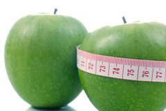 Apple and meter - Diet composition. Apple and meter on a white background - Diet composition stock photo