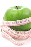 Apple and meter - Diet composition. Apple and meter on a white background - Diet composition stock photos
