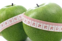 Apple and meter - Diet composition Royalty Free Stock Image