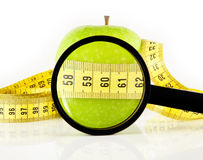 Apple meter and magnifying glass Royalty Free Stock Images