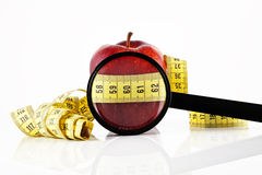 Apple meter and magnifying glass Royalty Free Stock Image