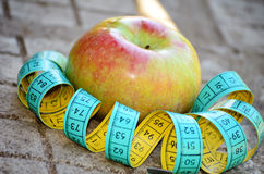 Apple and meter. Red apple and blue meter royalty free stock photos