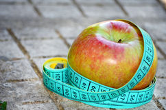 Apple and meter Royalty Free Stock Image