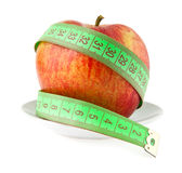 Apple and meter Royalty Free Stock Photos