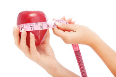 Apple with meter Royalty Free Stock Photos