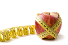 Apple and metre. On the isolated white background Royalty Free Stock Photo
