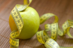 Apple and metric ribbon Royalty Free Stock Photography