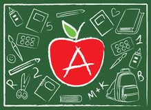 Apple in the middle of school accessories Royalty Free Stock Images