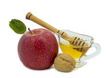 Apple, miel y nueces aislados en blanco Foto de archivo libre de regalías