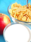 Apple, milk, and corn flakes Royalty Free Stock Photos