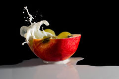 Apple with milk splash. Grapes, cold, natural royalty free stock images