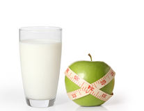 Apple  and milk on a white background Stock Images