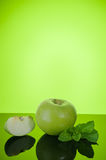 Apple with mint on green Royalty Free Stock Images