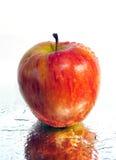 Apple on the mirror Stock Photo