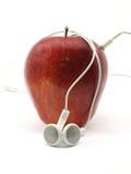 Apple mit Earbuds lizenzfreie stockfotos