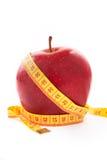Apple mit einem messenden Band. Lizenzfreies Stockfoto