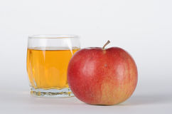 Apple mit Glas Lizenzfreie Stockfotografie