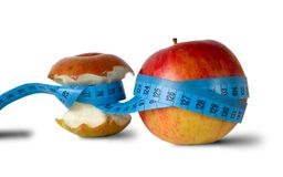 Apple mit Inch-nehmen auf Band auf Lizenzfreie Stockfotografie