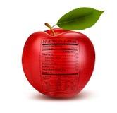 Apple mit Nahrungstatsachenaufkleber. Konzept von healt Lizenzfreies Stockfoto