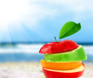 Apple mix. Mix the apples on the beach in blurred background Royalty Free Stock Photography