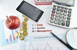 Apple, money,clock, telephone and calculator placed on document. For business concept Stock Photography