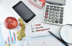 Apple, money,clock, telephone and calculator placed on document. Stock Photos