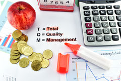 Apple, money,clock, telephone and calculator placed on document. Stock Photography
