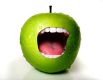Apple Mouth. A apple with a mouth wide open Royalty Free Stock Photo