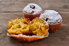 Apple Muffin. Closeup of an apple muffin on a rustic wooden board royalty free stock photography