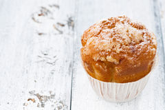 Apple muffin with icing sugar on white wooden background Royalty Free Stock Photos