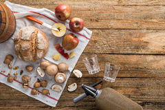 Apple , mushroom and bread with soda on a wooden table. Apple, mushroom, bread, nuts and soda on a rustic wooden table Stock Photography