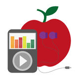 Apple with music player and earphones Stock Photo