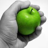 Apple na mão fotografia de stock