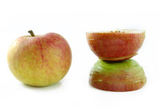 Apple in natural beauty and disfigured by cosmetic surgey Royalty Free Stock Images