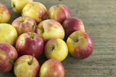 Apple of natural light. On wood background Royalty Free Stock Photo