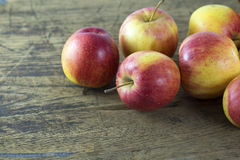 Apple of natural light. On wood background Stock Image