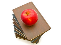 Apple near the books Stock Photo