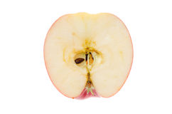 Apple nella sezione su un fondo bianco immagini stock libere da diritti