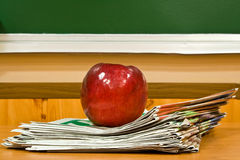 Apple and newspapers Royalty Free Stock Images