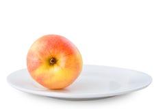 Apple no prato Fotografia de Stock