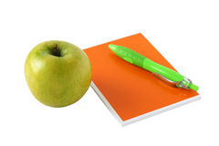 Apple with notebook Royalty Free Stock Photography