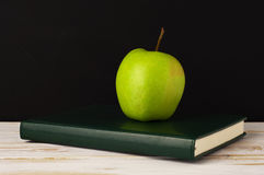 Apple on a notebook Royalty Free Stock Images