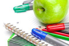 Apple, notebooks and pencils Stock Images
