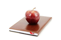Apple and notepad Stock Photography