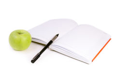 Apple, notes and pen Stock Photo