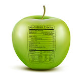 Apple with nutrition facts label. Royalty Free Stock Photo
