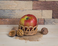 Apple and nuts in basket Stock Photo
