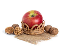 Apple and nuts in basket Royalty Free Stock Photos